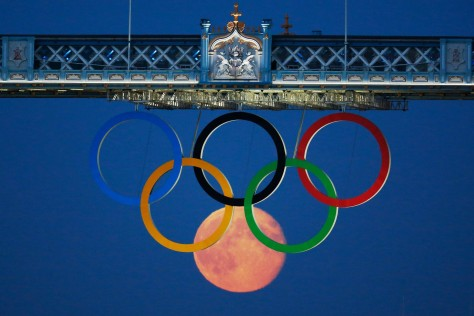 Full Moon rises through the Olympic rings at Tower Bridge in London 2