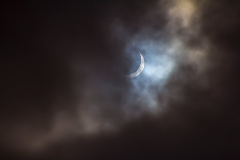 Cloudy Solar Eclipse over the Leeds by Carl Milner © 2015