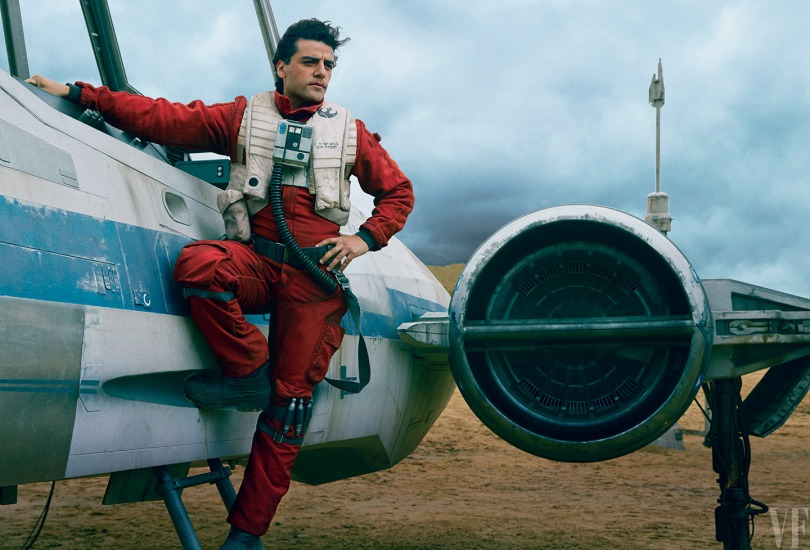 Dashing Resistance pilot Poe Dameron (Oscar Isaac) stands alongside his trusty X-wing fighter