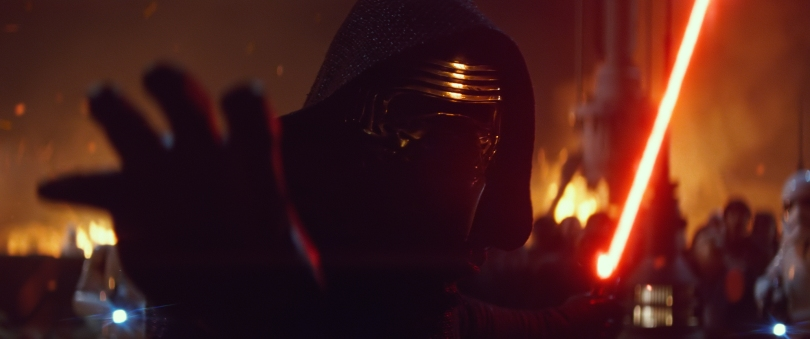 Kylo Ren turns and ignites his saber and reaches out using the force Star Wars The Force Awakens