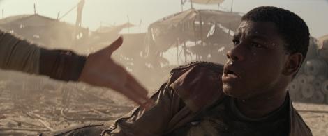 Rey helping Finn Star Wars The Force Awakens
