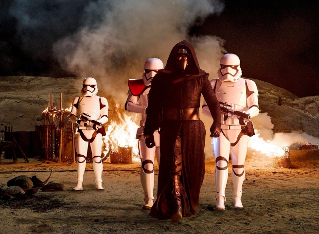 Kylo Ren amongst the smoldering ruins of a Jakku Village Star Wars The Force Awakens